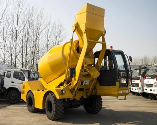 Self loading concrete mixer type